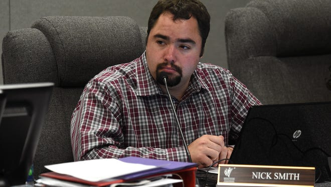 Washoe County School Board trustee Nick Smith has resigned after being accused of misconduct.