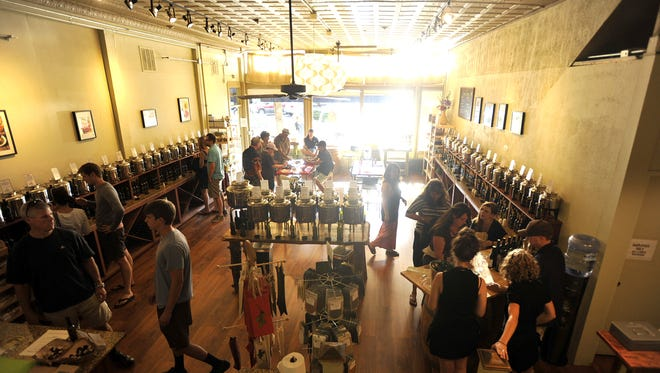People peruse Rocky Mountain Olive Oil Co. in Old Town Fort Collins in this July 19, 2013, file photo.