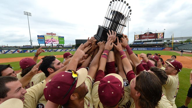 Florida State players hold up the trophy following their victory in the 2017 ACC Baseball Tournament in Louisville, KY, Sunday, May. 28, 2017.