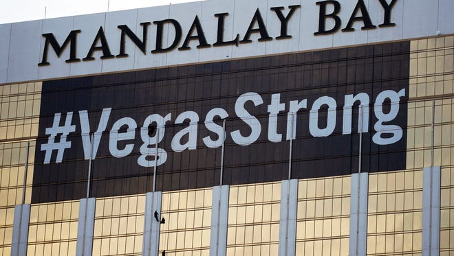 "FILE - In this Monday, Oct. 16, 2017, file photo, workers install a #VegasStrong banner on the Mandalay Bay hotel and casino in Las Vegas. Stephen Paddock opened fire from the hotel on an outdoor country music concert, killing 58 and injuring hundreds. Las Vegas' efforts to rebrand itself since the shooting show just how difficult it can be for organizations to hit the right tone after a deeply tragic event. The city put its famous ""What happens here, stays here"" slogan on hold, and its initial ad campaign after the attack won praise for its sensitivity. But a national TV commercial that features real social media posts from after the shooting is getting more mixed reviews, with some calling it tacky.(AP Photo/John Locher, File)"