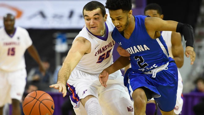 University of Evansville's Blake Simmons (50) and Indiana State's Jordan Barnes (2) battle for a loose ball as the University's of Evansville Purple Aces play the Indiana State Sycamores at the Ford Center Wednesday, January 17, 2018.