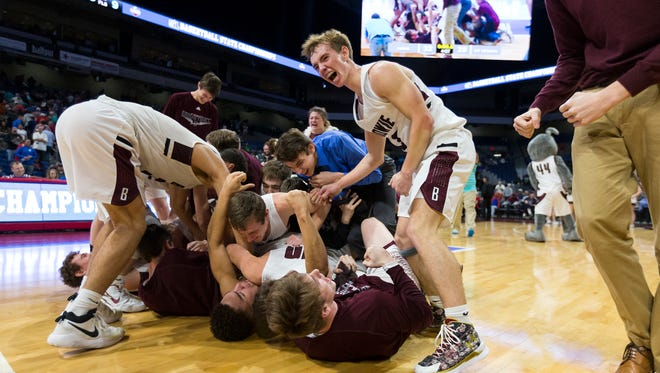 Bowie celebrates a 32-28 win over Mount Vernon during a UIL Class 3A boys high school state championship basketball game at the Alamodome in San Antonio, Friday, March 9, 2018. (Stephen Spillman)