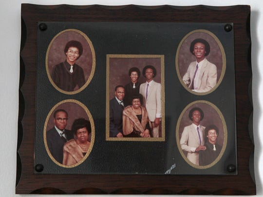 Family photos in Vernice Warfield's Rochester home.