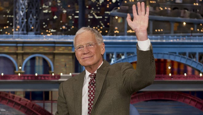 "David Letterman, host of the ""Late Show with David Letterman,"" waves to the audience in New York on April 3, 2014."