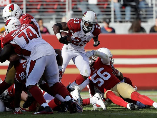 FILE - In this Nov. 5, 2017, file photo, Arizona Cardinals running back Adrian Peterson (23) runs against the San Francisco 49ers during an NFL football game, in Santa Clara, Calif. With ever-improving D.J. Humphries (74) at left tackle, the Cardinals finally seemed to have solidified their offensive line as it plows the way for Adrian Peterson. (AP Photo/Marcio Jose Sanchez, File)