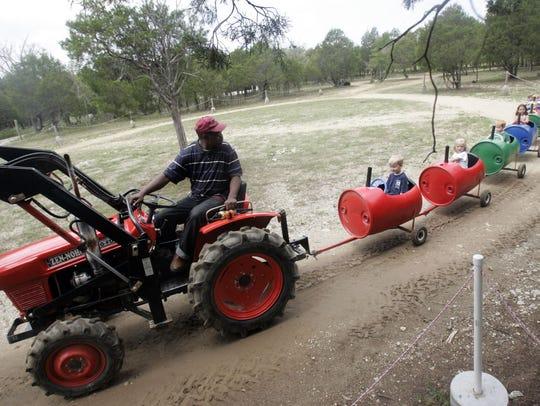 Lucky Ladd  Farm employee Patrick Perkins takes kids
