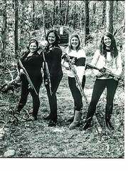 Damien Payne's girlfriend, Megan Heath, is pictured with her friends and their guns in this photo, shown to the jury during Payne's criminal trial, at which he was acquitted of being a felon in possession of a firearm.