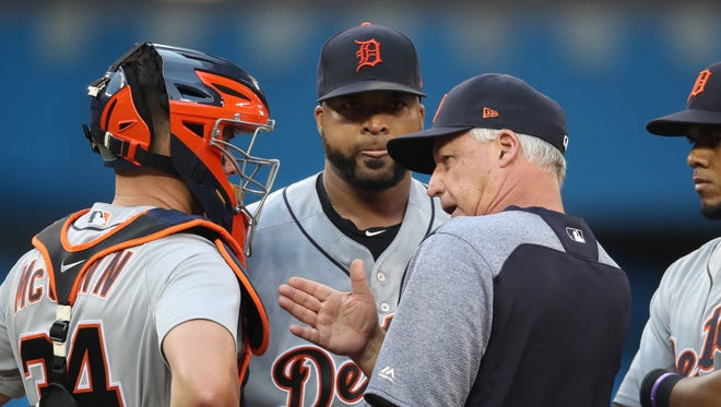 Tigers starter Francisco Liriano is visited on the mound by pitching coach Rick Anderson in the fourth inning.