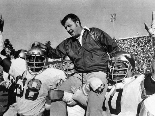 In this Dec. 3, 1977 photo, Florida State head coach Bobby Bowden is carried on the shoulders of defensive end Willie Jones (88) and nose guard Ron Simmons (50) after Florida State defeated Florida 37-9 in Gainesville for the program's first win over the Gators since 1967.