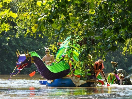 'Drag On' floats down the French Broad River during the Anything That Floats Parade on Saturday, August 13, 2016 at Hominey reek Park in Asheville. MIKE RICE/Citizen Times