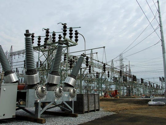 New Jersey regulators cut JCP&L's rates by $34.3 million, far below the $115 million they said they would order if not for superstorm Sandy. Pictured is JCP&L's Raritan River substation in Sayreville.