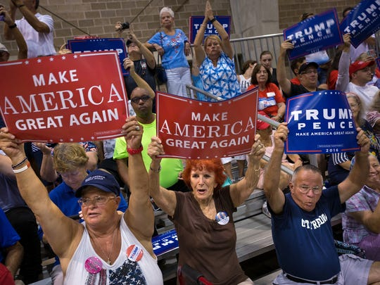 Supporters cheer for an opening speaker during a campaign rally for Republican presidential nominee Donald Trump at the Florida State Fairgrounds on Wednesday, Aug. 24, 2016, in Tampa. Trump spoke about a variety of issues including jobs, immigration, national security, trade and Hillary Clinton at the event.