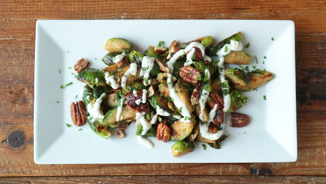 Brussels sprouts with pecans and herb goat cheese from Chef Eric Morris of New Albany restaurants Hull & High Water and Gospel Bird.
