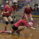 Ava Battaglia, No. 8 of the Escambia High Gators, digs deep to try and return this ball against the Pensacola High Tigers during their game Thursday night at EHS, part of the EHS Dig Pink event.