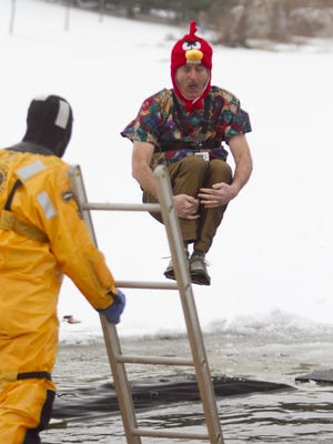 Costumes perhaps put the impending task at hand out of mind for those about to plunge into icy water in the 2015 Polar Plunge.
