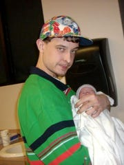 William Joseph Nachlinger holds his niece.