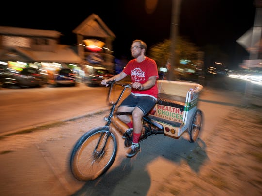 Pedicab driver Payton Hatfield, of Gulf Coast Pedicab