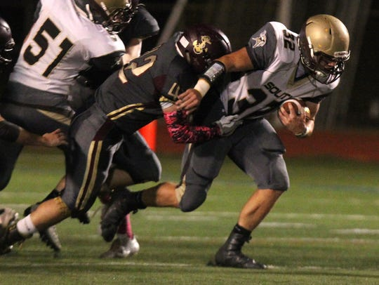 Clarkstown South's Sam Franco is tackled by Arlington's