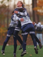 Teammates swarm Abby Wambach, center, after she scored