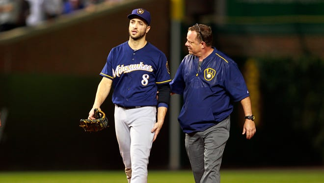 Ryan Braun leaves the game after sliding into the wall at Wrigley Field on Tuesday, Aug. 16 in the night game of their doubleheader. The Brewers lost, 4-1.