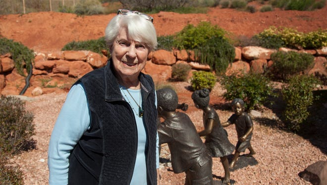 L'Deane Trueblood stands with some of her sculptures at her home in St. George.