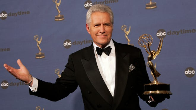 """On April 28, 2006, Alex Trebek holds the award for outstanding game show host for his work on """"Jeopardy!"""" backstage at the 33rd Annual Daytime Emmy Awards in Los Angeles."""