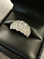 The winner of this 14-karat white gold ring, donated