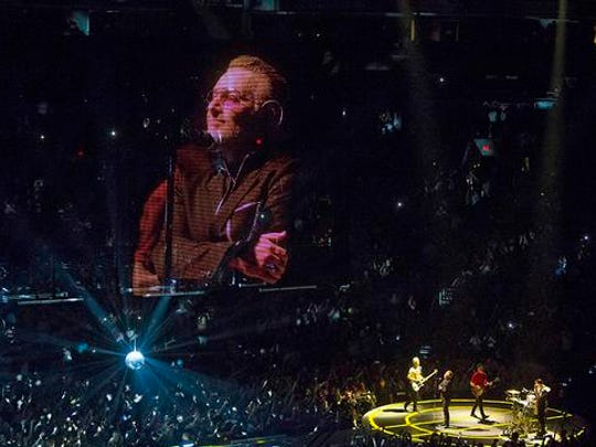 U2 performing in Phoenix at US Airways Center during their iNNOCENCE + eXPERIENCE Tour.