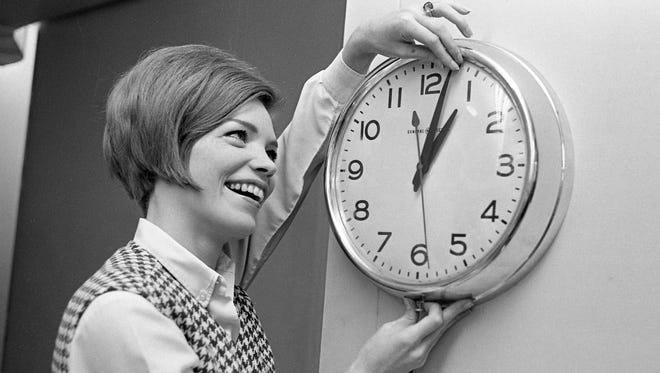 Nancy Shipley, Associated Press reporter, turns back the clock an hour in AP office at The Tennessean Oct. 28, 1967 as Standard Time returns.