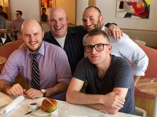 Tennessean staffers pose with the burger at Little
