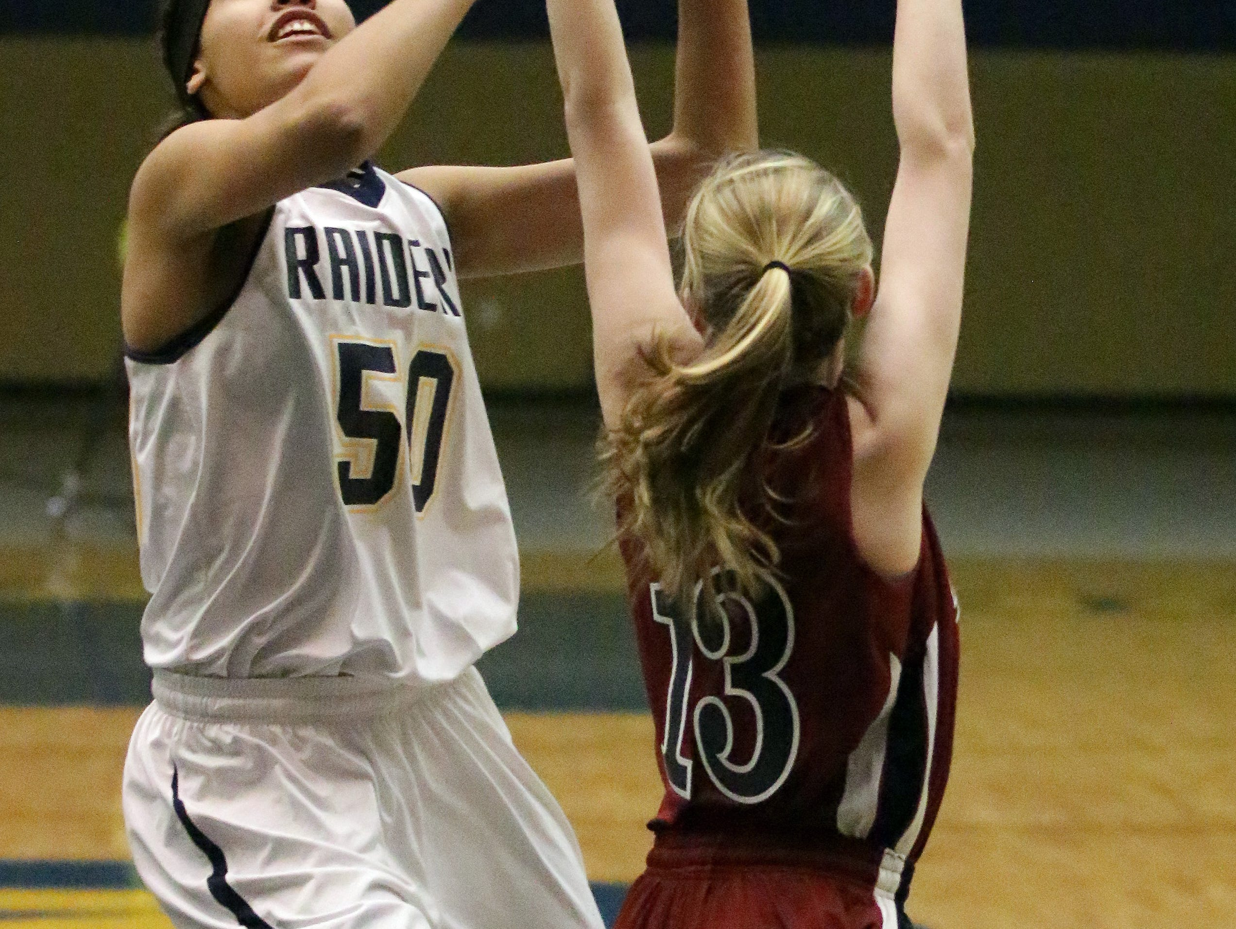 Junior center Kiara Dallmann (50) will be counted on to take on a bigger role with the Golden Raiders this year.