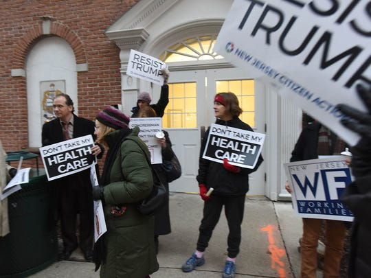 Advocates of the ACA gathering Wednesday outside Republican congressional offices in Morristown.