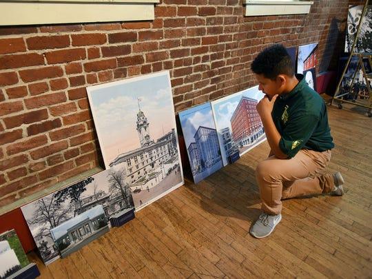Joel Tejeda checks out the new exhibit called Paterson-Washington,