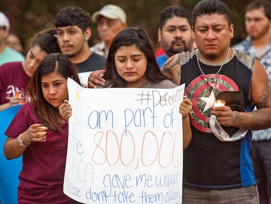 Karina Fraga, who is temporarily protected from deportation under the federal Deferred Action for Childhood Arrivals program, or DACA, prays during a vigil in Tyler, Texas.