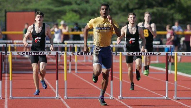 Manchester High School senior Jordan Toreny, 17, runs away from the field to finsih first in the first heat of the 400-meter Intermediate Hurdles race at the Ocean County Track and Field Championship, at Central Regional High School, Berkeley Township, May 12, 2016.Jerry Wolkowitz/Correspondent ASB 0513 Ocean County Track 051216a