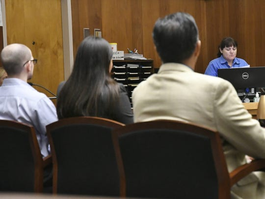 A court clerk reads the verdict against Aaron Rowe