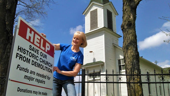 This new sign now announces the drive to save St. Mary's Newport Church of rural Solon.  Longtime caretaker Joan Frees is spearheading the campaign with help from the church association's board.