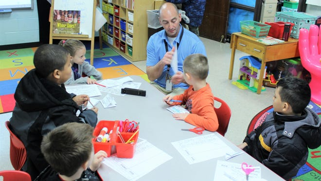 """Peter Dworetsky talks with a group of students in the Benjamin Cosor Elementary """"Buddy program."""" Dworetsky encourages the students to always ask for help and guidance."""