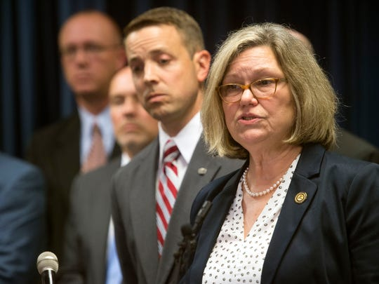 Nancy Stallard Harr, U.S. Attorney for the Eastern District of Tennessee, announces the district's participation in the Department of Justice's Opioid Fraud and Abuse Detection Unit. At left is Assistant U.S. Attorney David Lewen.