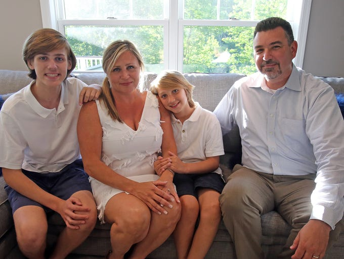 Paul and Jennifer and Kooney and their two sons, Colin