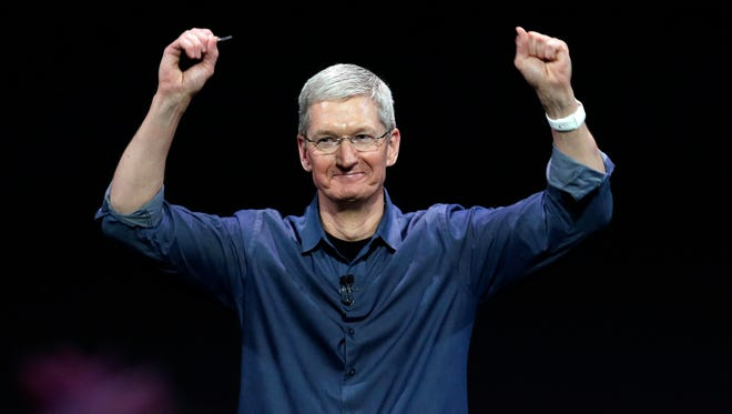 Apple CEO Tim Cook introduces the new Apple Watch, which he is wearing, on Sept. 9, 2014, in Cupertino, Calif. Apple's new wearable device marks the company's first major entry into a new product category since the iPad's debut in 2010.