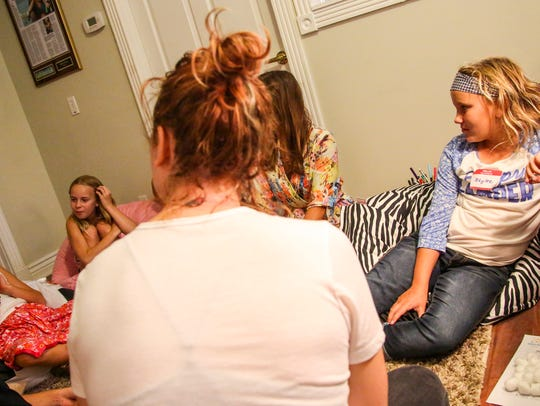 Pre-teens talk in their therapy session. This night