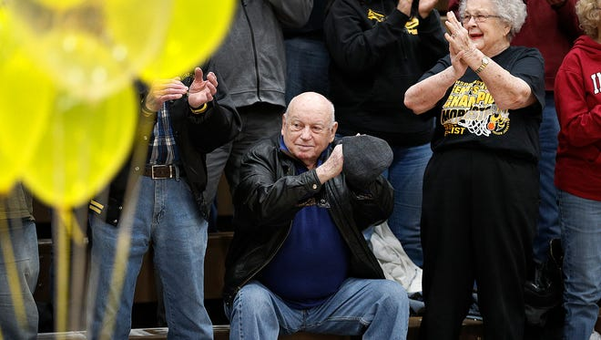 Wayne Wood,left, and his wife Martha Wood during a pep rally for the boys basketball team. The town of Morristown, IN., in Hanover Township, Shelby County, is ready for the IHSAA Boys Class A basketball state finals game at Bankers Life Fieldhouse.
