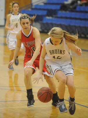 Flippin's Sydney Riggs (15) races past Pulaski Academy's Lauren Yager (12) for a loose ball during the Lady Bobcats' 1st Arkansas Bail Bonds Tournament game against the Lady Bruins on Monday at The Hangar. Pulaski Academy posted a 56-31 win in the first round of the event.