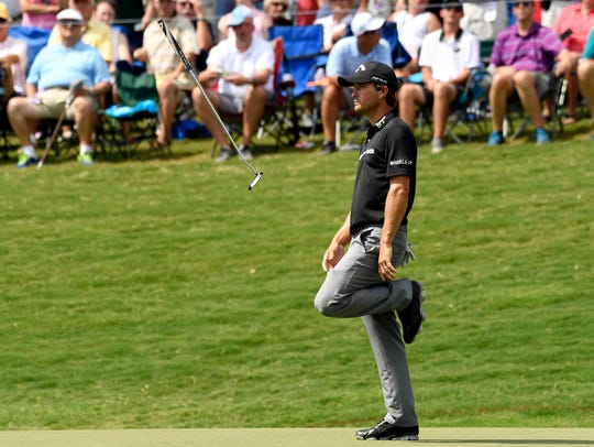 Kevin Kisner reacts to his putt on the 18th green during