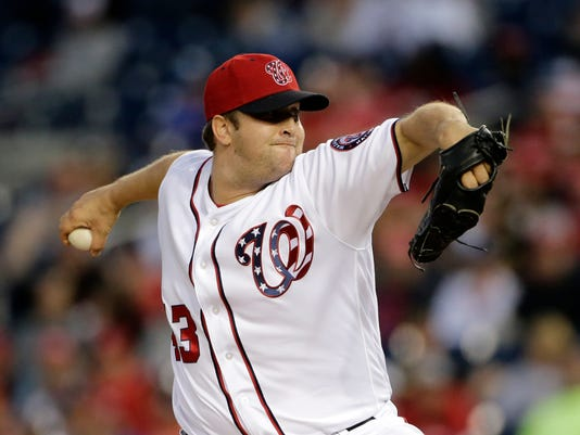 FILE - In this Oct. 1, 2017, file photo, Washington Nationals relief pitcher Matt Albers pitches during a baseball game against the Pittsburgh Pirates in Washington. Albers has finalized a $5 million, two-year contract with the Milwaukee Brewers on Tuesday, Jan. 30, 2018. The 35-year old is coming off a standout season in Washington, where he was a career-best 7-2 with a 1.62 ERA in 63 games. (AP Photo/Mark Tenally, File)