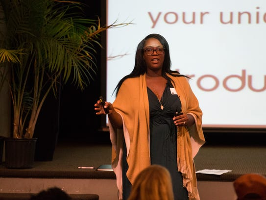 Tynisha Lomax gives her pitch for her tea company, Levitea, at Theater N earlier in November.