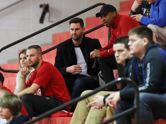 Former U of L basketball player Luke Hancock, center, watched Aspire Academy play against Orangeville Prep at Seneca High School.  