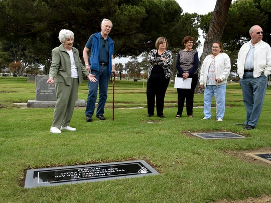 """Val Rains, left, and Sherwood """"Woody"""" MIlleman discuss the history of a common grave at Ivy Lawn in Ventura, where some of Camarillo's founding residents were moved from local plots several decades ago. The pair worked for many years to identify those buried at the site and were instrumental in getting a grave marker installed."""