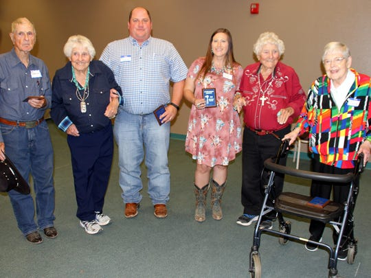 The Kretek Twins upheld a tradition of awarding the oldest and youngest male and female at the Luna County Old-Timers' Association Reunion. From left are A.B. Cheatham, 89; Gert Kretek, Ryan Smrkovsky, 39; Karen Reed, 31; Gerry Kretek and Tana Spivey Gosdin, 96.